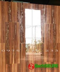Gạch trung quốc ánh kim nhũ vàng 60×120 giả vân gỗ bóng kiếng mẫu đẹp